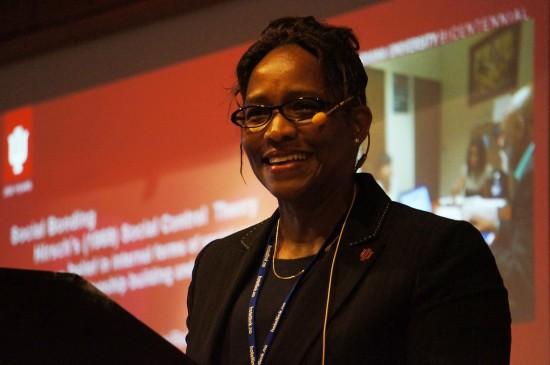 Carolyn Gentle-Genitty på talerstolen under den første INSA-konferansen i 2019
