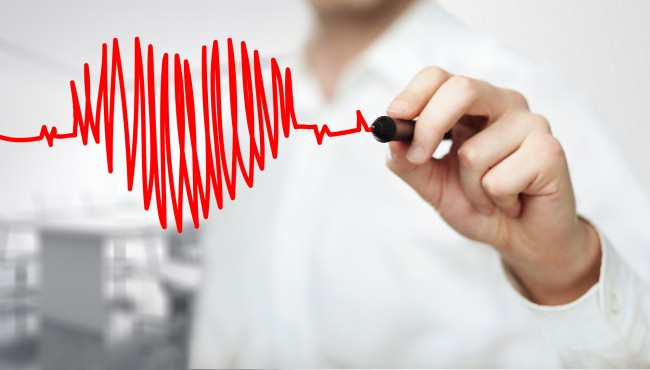 Stock photo of medical expert drawing a heart